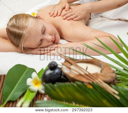 Spa Massage. Beautiful Young Blonde Woman Getting Spa Massage. Relax Concept