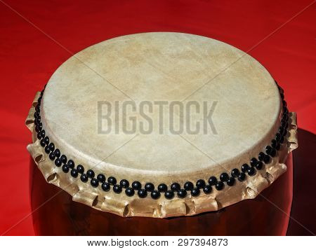 A Big Taiko Drum O-daiko On Isolated Red Background. Musical Percussion Instrument Of Asia