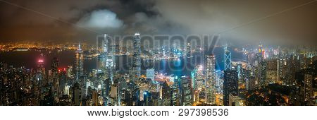 Panorama Aerial View Of Hong Kong City Skyline At Night Over The Clouds