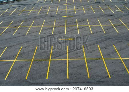The Marking Lines In The Parking Lot With Yellow Paint On Asphalt. Large Parking Lot, Empty