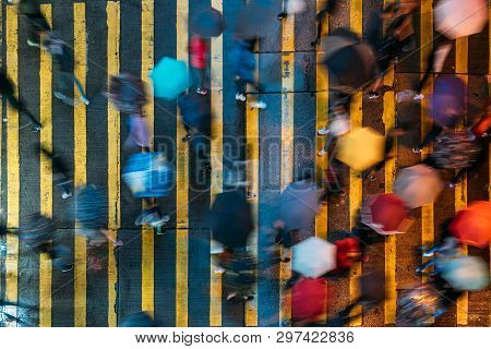 Top View Of People Crossing A Very Busy Crossroads In Mong Kok District Hong Kong, China