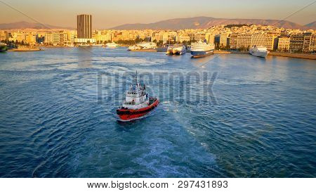 Athens, Greece - October 30th:  Port Of Piraeus With Athens Skyline In Background In Athens, Greece