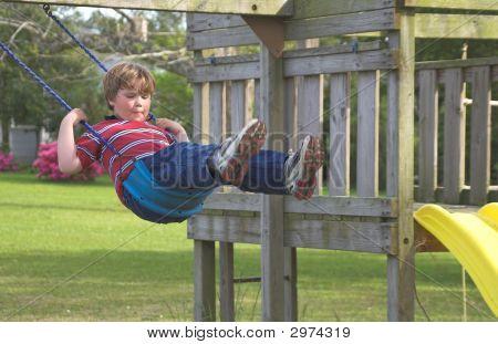 Boy On A Swing