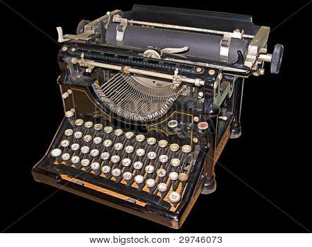 Old typewriter isolated in black