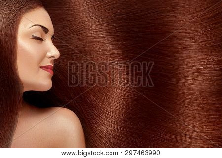 poster of Beautiful Hair. Beauty woman with luxurious long hair. Beauty Model Girl with Healthy red Hair. Pretty female with long smooth shiny straight hair. Hairstyle. Keratin straightening.