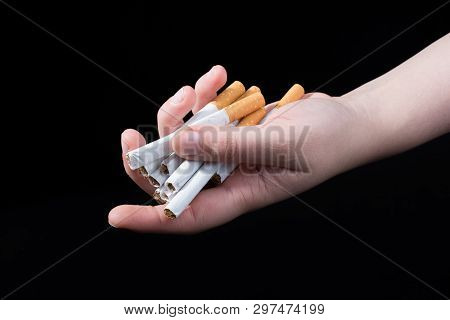 Hand Is Giving Out Cigarettes On A Black Background