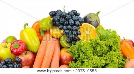 Heap fresh fruits and vegetables isolated on white background