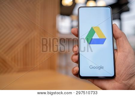 Chiang Mai, Thailand - Mar. 23,2019: Man Hands Holding Xiaomi Mi Mix 3 With Google Drive Apps On Scr