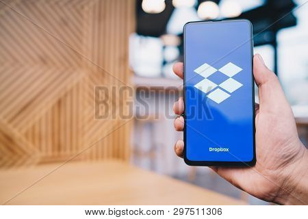 Chiang Mai, Thailand - Mar. 23,2019: Man Holding Xiaomi Mi Mix 3 With Dropbox On Screen.dropbox Is A