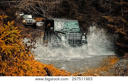 Mud And Water Splash In Off-road Racing. Off Road Sport Truck Between Mountains Landscape. Expeditio
