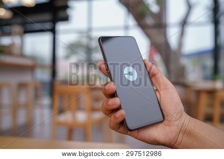 Chiang Mai, Thailand - Mar. 23,2019: Man Holding Xiaomi Mi Mix 3 With Uber Apps. Uber Is Smartphone