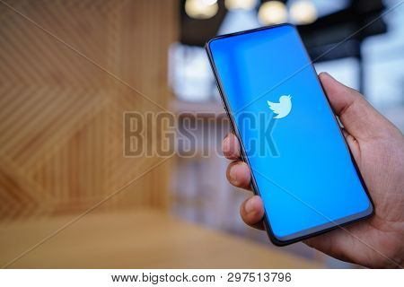 Chiang Mai, Thailand - Mar. 23,2019: Man Holding Xiaomi Mi Mix 3 With Twitter App On The Screen.twit