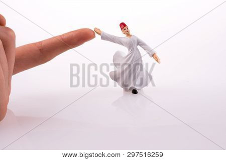 Hand holding a Sufi Dervis on a white background poster
