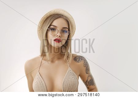 Young Tender Blonde Woman Posing In Fashionable Knit Swimsuit Glasses And Hat. Stylish Sensual Girl