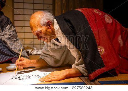 Tokyo, Japan - April 25, 2018: View Of An Animatronic Figures Of The Ukiyo-e Artist (japanese Woodbl