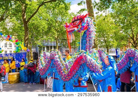 London, Uk - May 13 2018: Unidentified People Perform Dragon Dance For Promoting The Falun Gong Chin