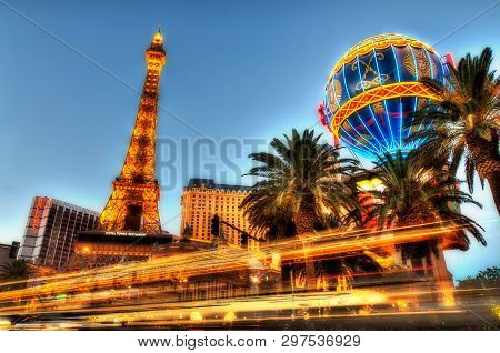 Las Vegas, Usa - July 18, 2014: Paris Hotel Low Angle Long Exposure At Evening. Traffic Drives By On