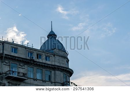 With Houses Made Of Stone Bricks. Daytime Landscape Dome Building Blue Sky. Building Dome At Dusk