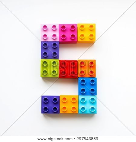 Number Five Made Of Colorful Constructor Blocks. Toy Bricks Lying In Order, Making Number 5. Educati