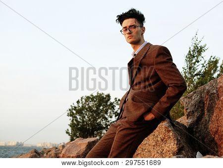 Elegant fashionable man in glasses