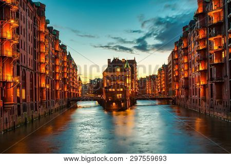 The Warehouse District Speicherstadt During Twilight Sunset In Hamburg, Germany. Illuminated Warehou