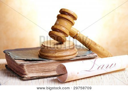 Old book and gavel with old paper with word law