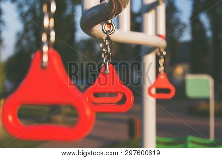 Path With Hanging Climbing Rings In A Playground.