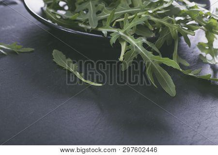The Arugula Leaves Isolated On Black Background.
