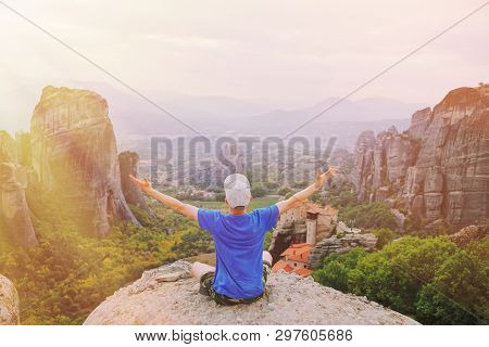 Man Traveler Praying At Sunset Mountain Summit Enjoying Aerial Epic View Raised Hands Travel Lifesty