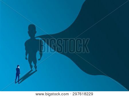 Businessman Looking To Way Success With A Superhero With Cape Shadow On The Wall. Ambition And Busin