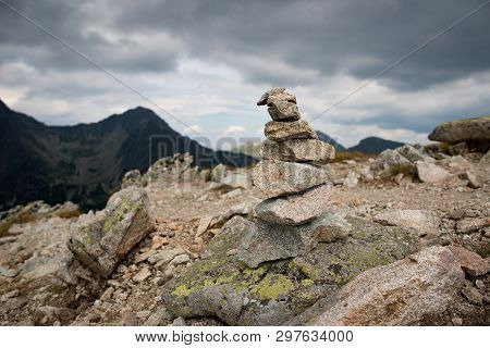 Stones Stacked On Top Of Each Other In The Mountains