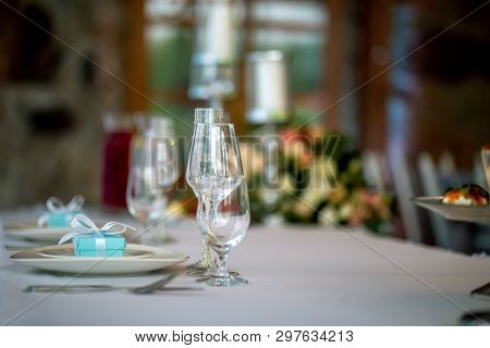 Festive Table Setting With Decorated Glasses And Handmade Gift Boxes. Handmade Gift Box In Plate And