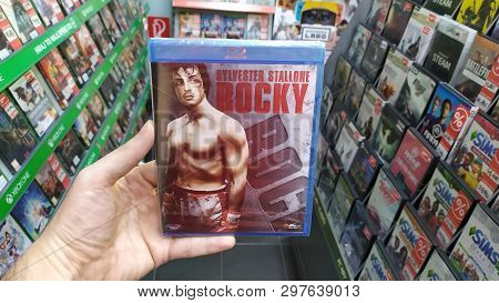 Bratislava, Slovakia, April 25, 2019: Man Holding Rocky Movie On Blu-ray Disc In Store In Store