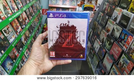 Bratislava, Slovakia, April 25, 2019: Man Holding World War Z Videogame On Sony Playstation 4 Consol