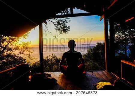 Buddhist Monk Meditation In Tropical Forest