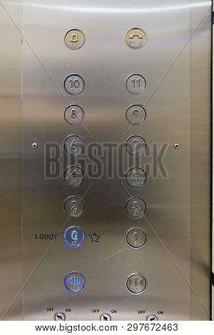 Elevator Buttons On Metal Panel With Ground Floor Pressed