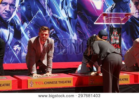 LOS ANGELES - APR 23:  Chris Hemsworth, Chris Evans at the Avengers Cast Members Handprint Ceremony at the TCL Chinese Theater on April 23, 2019 in Los Angeles, CA