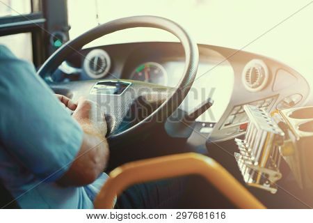 Hands Of Driver In A Modern Bus By Driving. Concept Of Bus Driver Steering Wheel And Driving Passeng