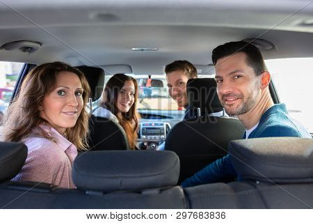 Smiling People Sitting Inside The Ride Sharing Car