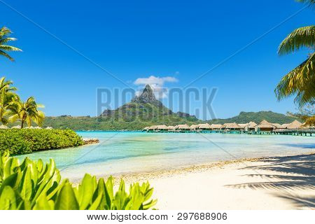 View On Mount Otemanu Through Turquoise Lagoon And Overwater Bungalows On The Tropical Island Bora B