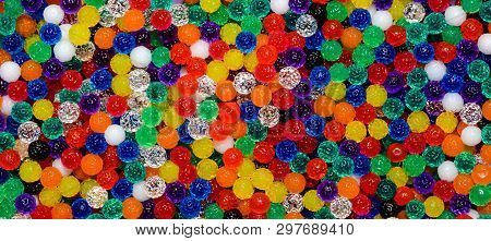 Tiny Textured Jelly-like Multicolored Beads Forming An Artsy  Banner Background