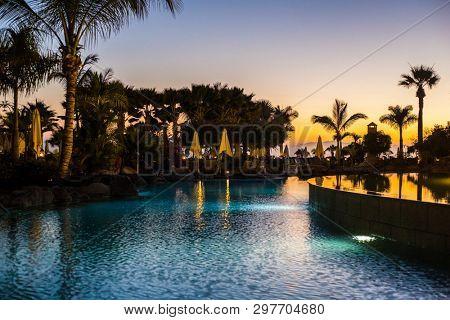 TENERIFE ISLAND, SPAIN - JULY 17: Sunset on a luxury hotel on July 17, 2016 in Tenerife, Spain.