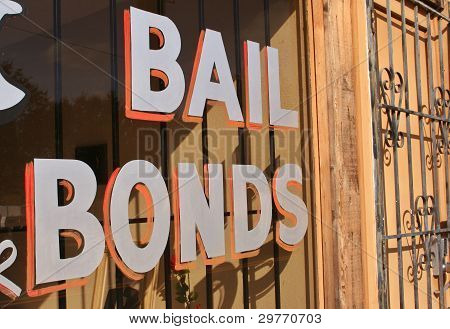 Bail Bonds Sign in Window With Metal Bars poster