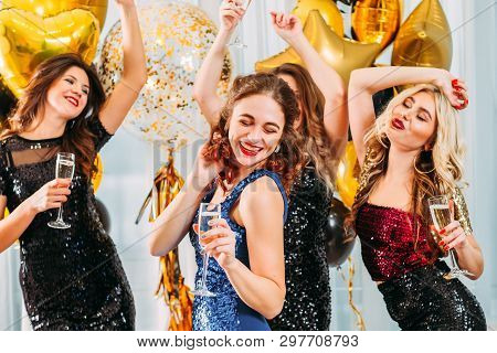 Fancy Party. Ladies Celebrating Their College Graduation At Home. Girls Dancing With Champagne In Ro