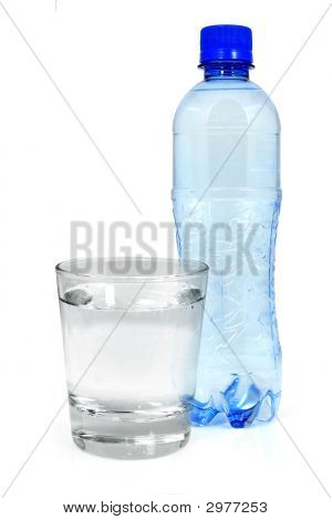 Blue Bottle And Glass Of Water