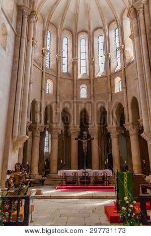 Alcobaca, Portugal - July 17, 2017: Altar or Main Chapel, ambulatory and apse of Monastery of Santa Maria de Alcobaca Abbey. Medieval Gothic architecture. Cistercian Religious Order
