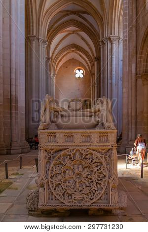 Alcobaca, Portugal - July 17, 2017: Gothic Tomb of King Dom Pedro with recumbent effigy. Monastery of Santa Maria de Alcobaca Abbey. Funerary art Masterpiece.