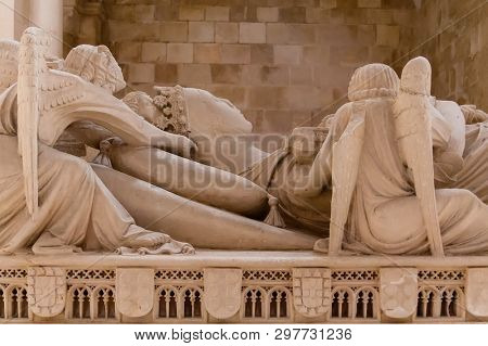 Alcobaca, Portugal - July 17, 2017: Gothic Tomb of Queen Ines de Castro with recumbent effigy and angels. Monastery of Santa Maria de Alcobaca Abbey. Funerary art masterpiece.