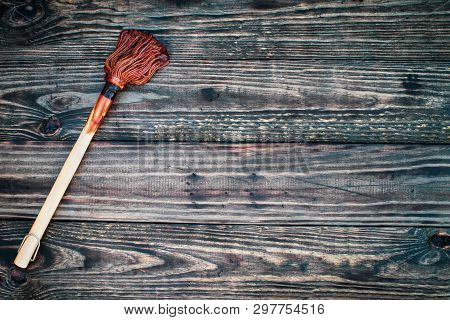 Bbq Mop Or Brush Over Top A Rustic Wood Table / Background With Barbecue Sauce On End. Image Shot Fr