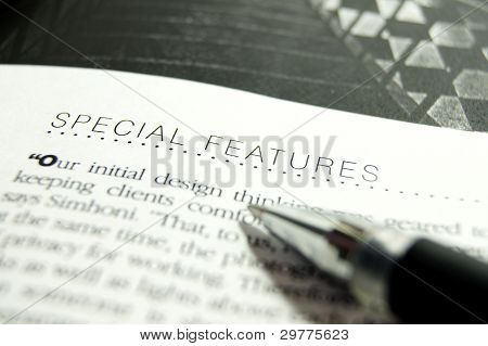 text on book and pen